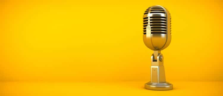 golden microphone for podcast on yellow background