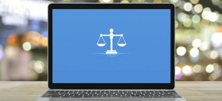 mac laptop with law symbol on screen