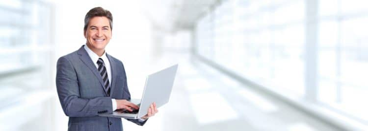 smiling lawyer in suit holds computer