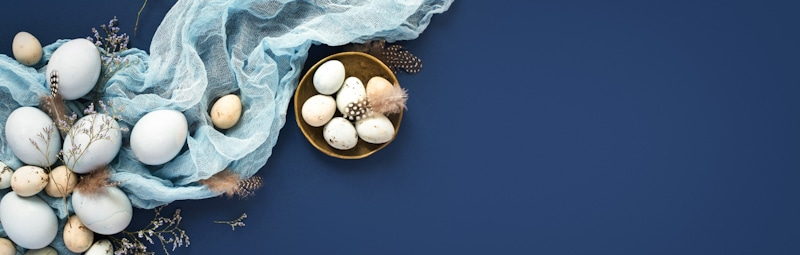 easter eggs golden white and silver in blue background