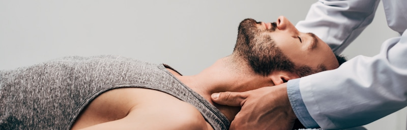 man lays on table getting chiropractic adjustment