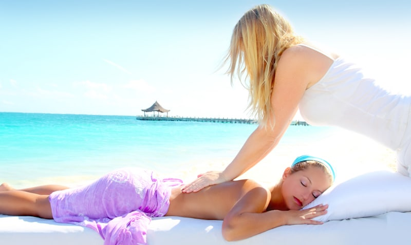 woman gets massage by the beach
