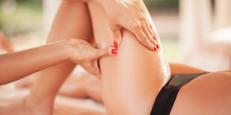woman gets massaged on the thigh