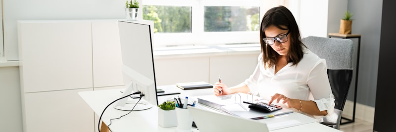 accountant does calculations in white clean office
