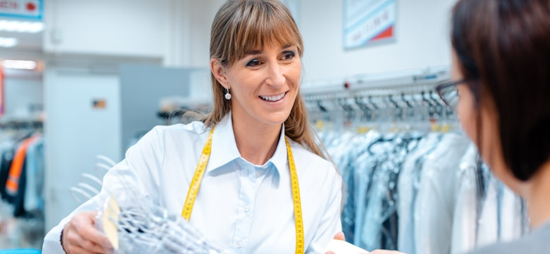 business owner has friendly interaction with customer