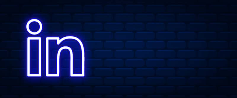 linkedIn logo art in neon with brick background