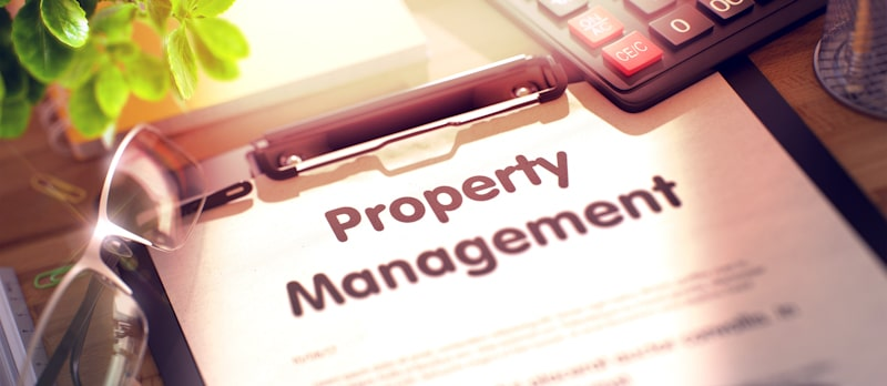 property management sign with glasses on paper